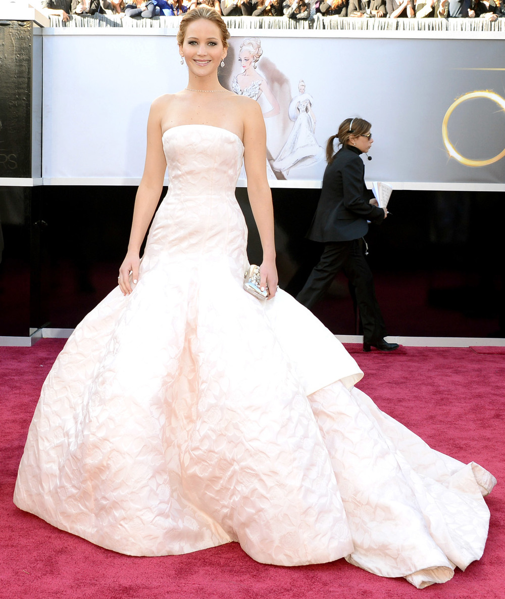 Jennifer Lawrence, wearing Dior in 2013, was memorable because she tripped on the stairs on her way to get the Oscar, but also for being so glamorous and simple at the same time.