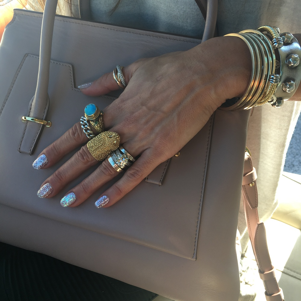 Gel glitter and filigrana nails by Nails 4 Us, bag by Tom Ford.