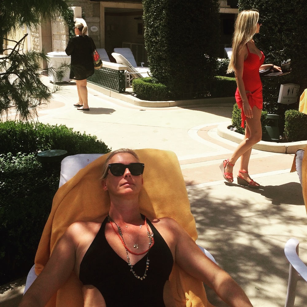 Tanning by the pool in Vegas.