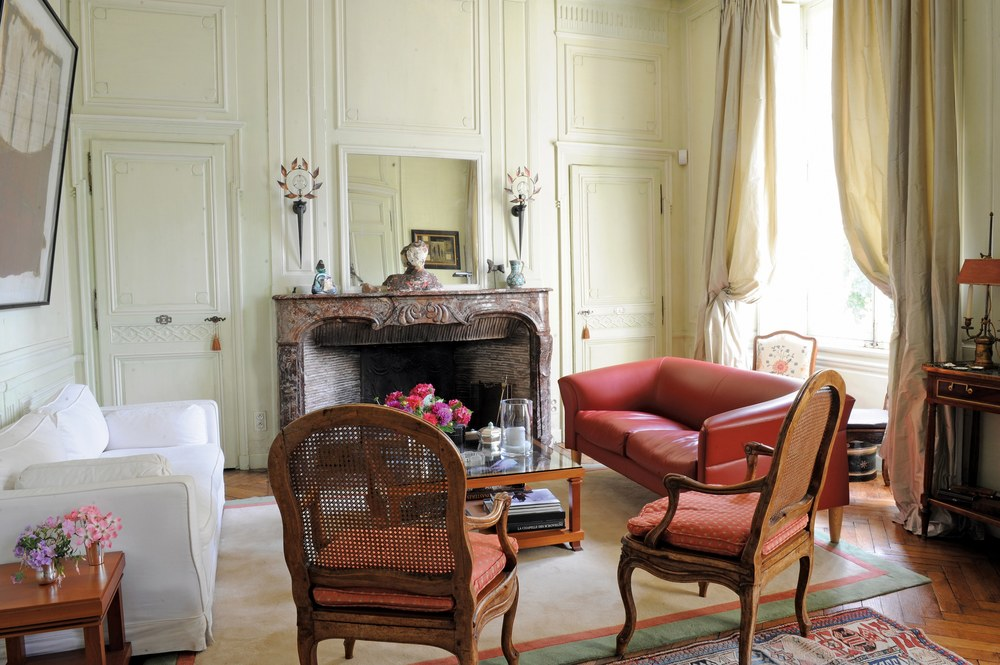 Evelyne, who has a classic 19th-century house decorated with antique furniture and contemporary art.