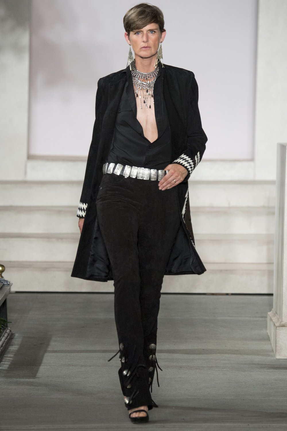 Masculine tailoring with extraordinary silver accessories that cinch the deal.