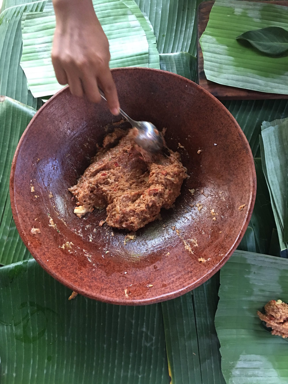 Mixing the minced beef with the spices