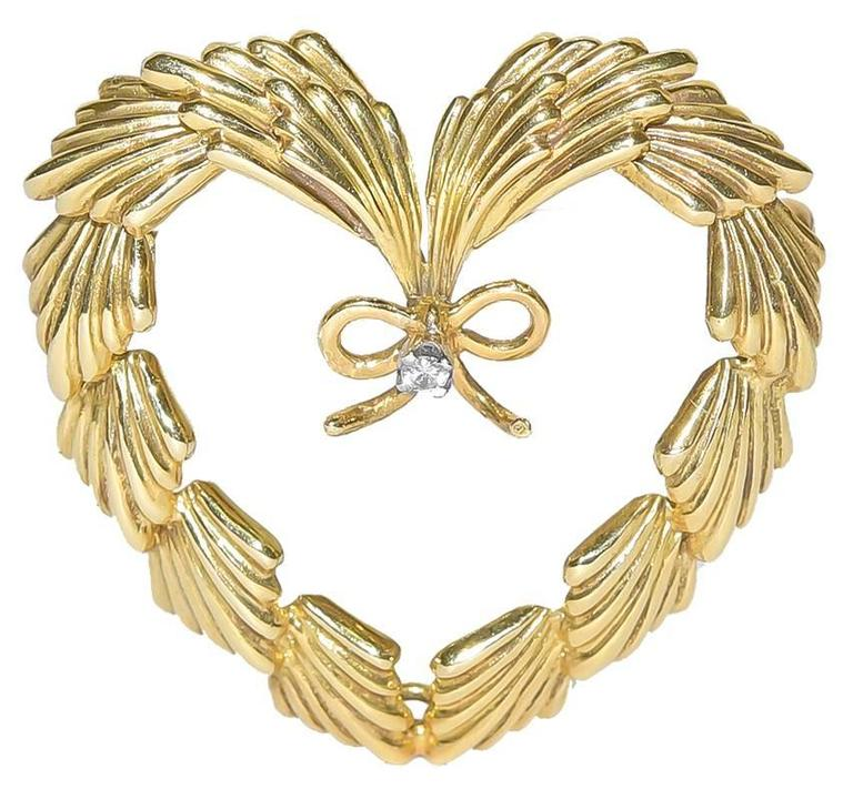 Cartier gold and diamond brooch.