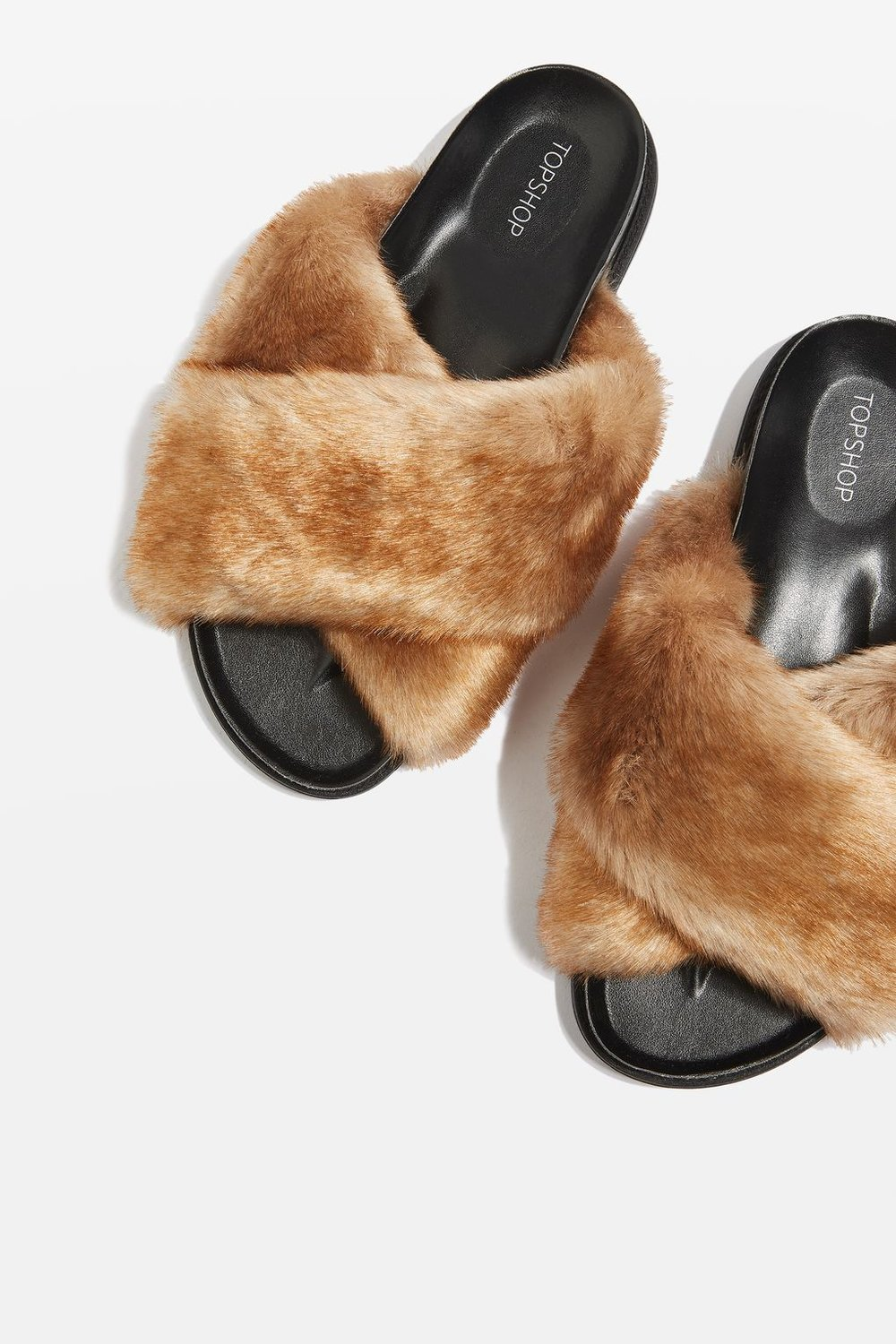 At Topshop, 40 euros gets you these bushy slides.