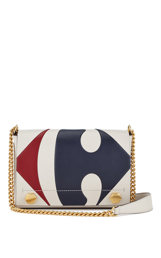 Very chic take on an everyday shopping bag, also very English eccentric.