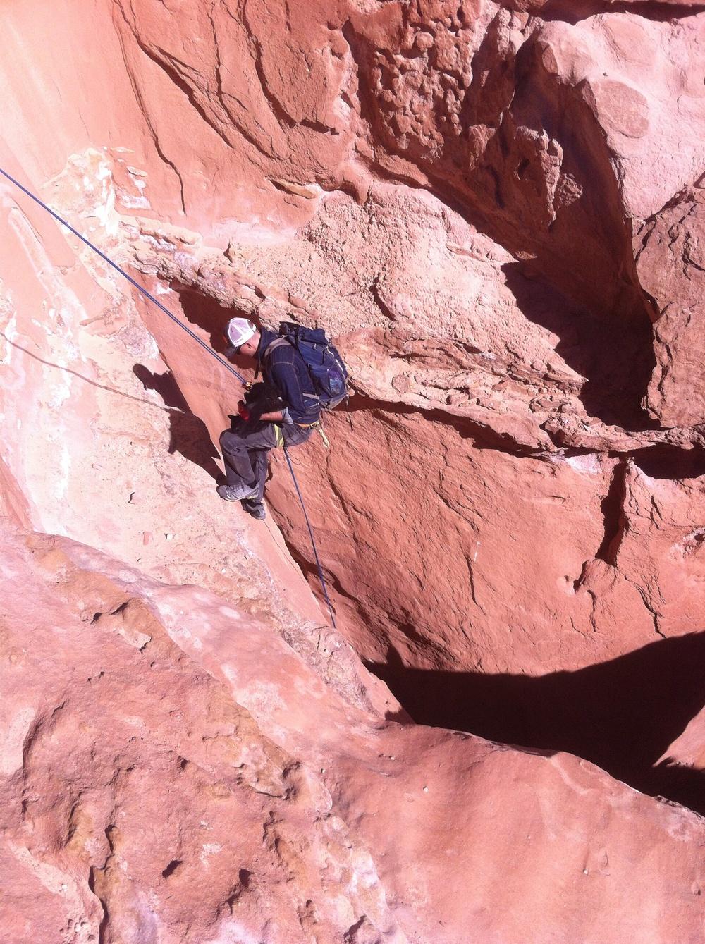 Craig drops down the second rappel.