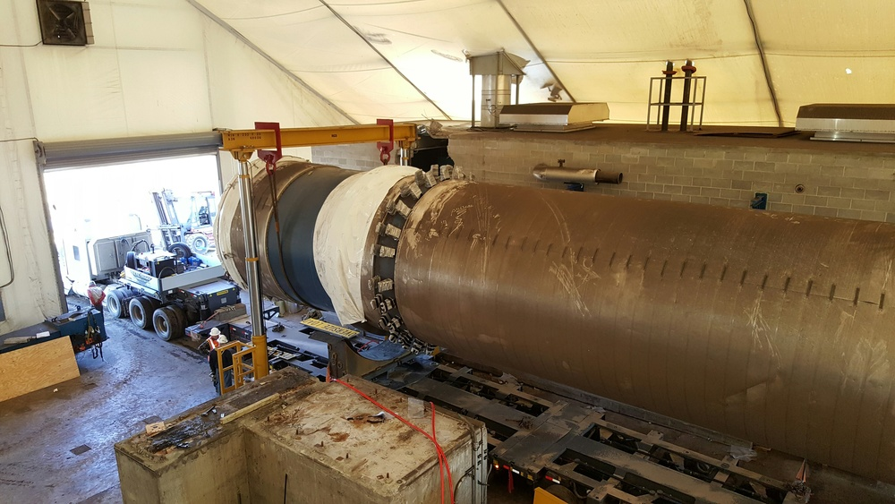 "Tear down, rigging and loading of a 243,000 pound ""Rotary Steam Tube Dryer."""