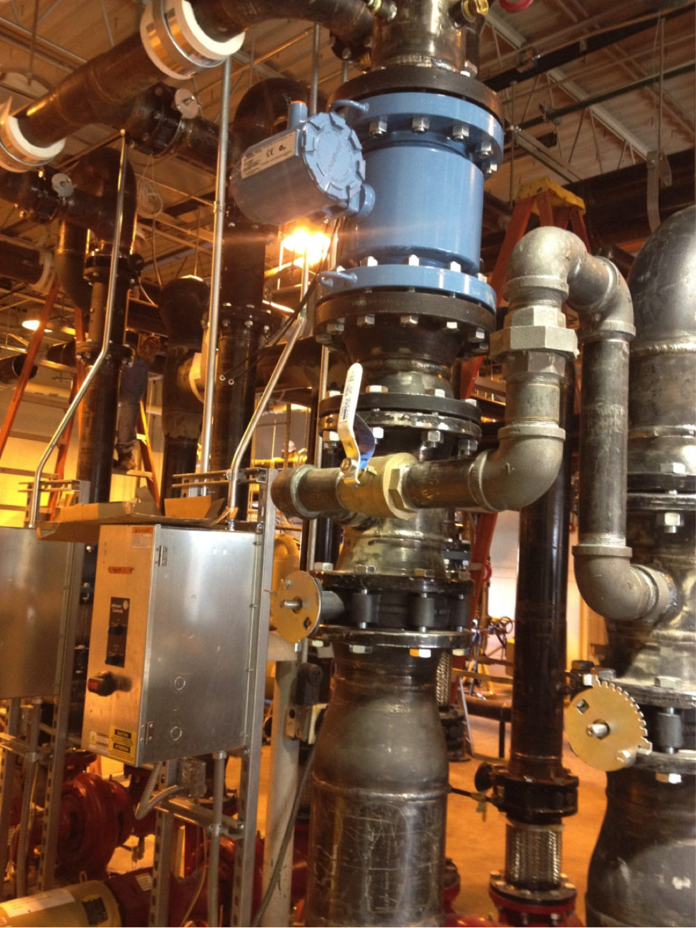 A view of the major piping and chiller unit.