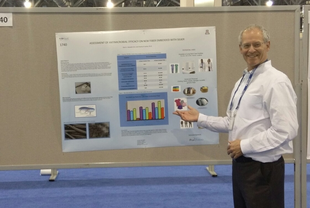 Dr. Greenfield at IDWeek 2014 by the poster bearing Dr. Gerba's results. (We got it straightened out after taking this shot...)