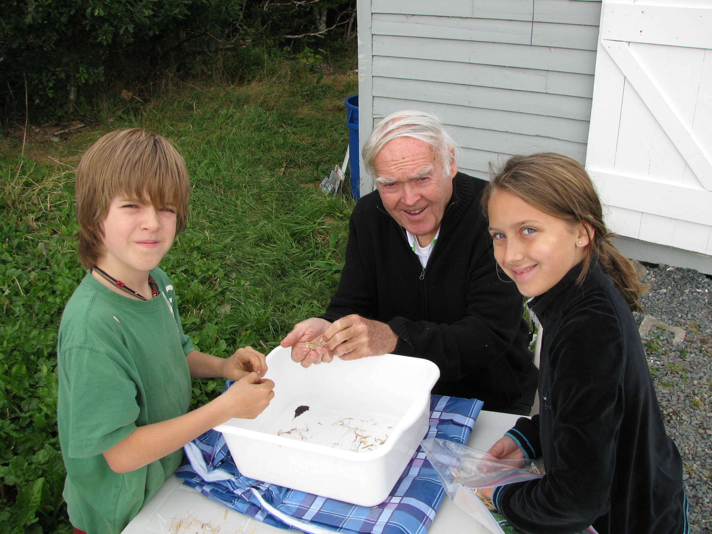 Children learn how to save seed for next year at the Brother McSheffrey Community Garden in St. John's. Photo credit: Sonya Clarke-Casey