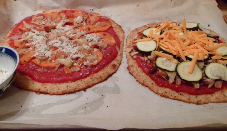 The pizzas before going in the oven.