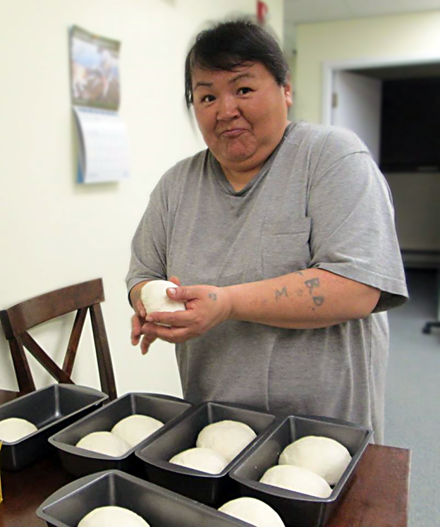 "Kitura is a member of the NiKiKautik (""A Place Where Food Is"") Cooking Program, a traditional Inuit and contemporary cooking skills education program. A group meets with their cooking instructor, Regina Dicker of Food First NL, once a week to prepare a variety of food, and the participants take that food home at the end of the day. After a recent bread-baking workshop, Kitura's first time baking her own bread, she left with six fresh loaves and by the time she got home she had only two loaves left—she was so proud of her work she gave four loaves away on her walk home."