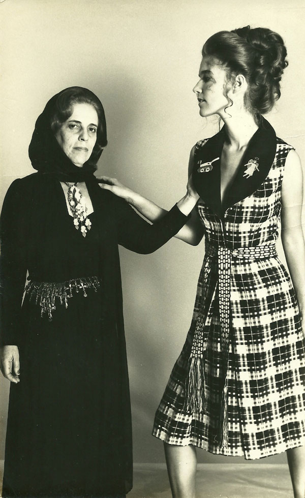 "Zuzu Angel (left) in all black after her son's death. To her right, a model wearing a dress from Zuzu's ""Helpless Angel"" collection."