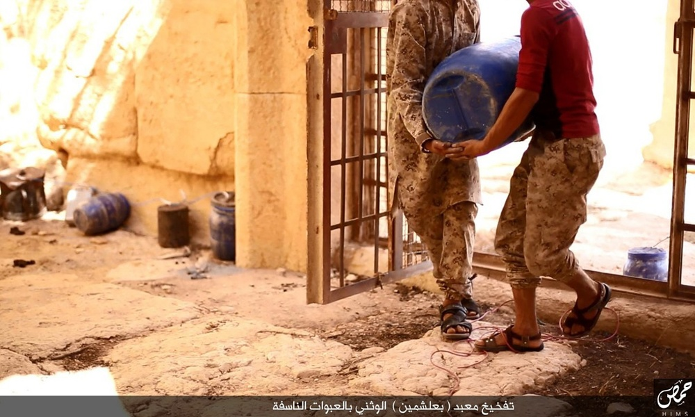 Images published by Isis claim to show two men carrying explosives into Baal Shamin.   Photo by   ISIS  /Homs region.
