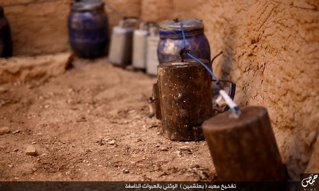 Explosives seemingly wired to the outside of the temple. Photo by   ISIS  /Homs region.