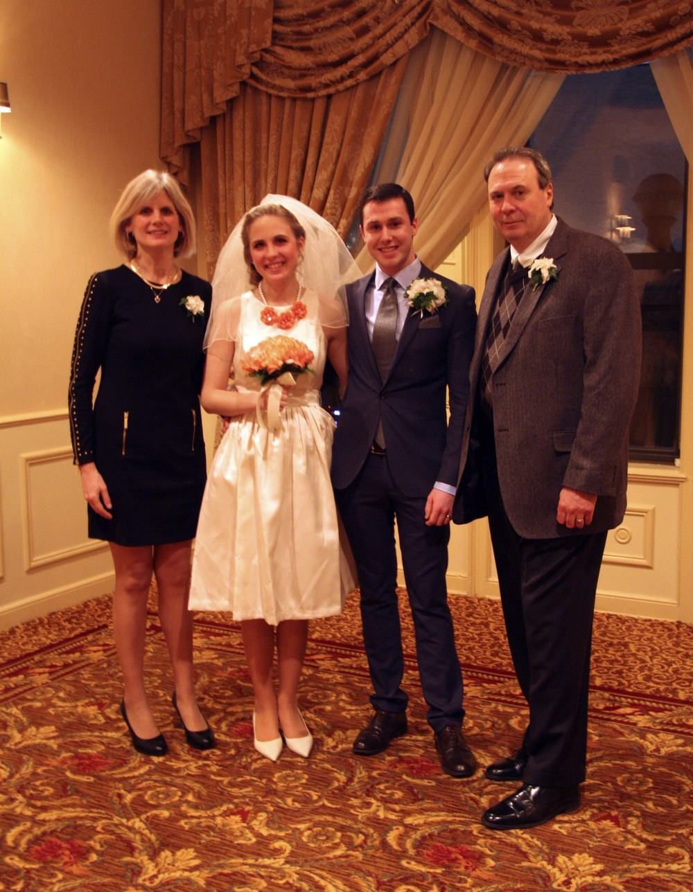 From left to right: Kris, Katy, Alex and George. Photo taken at Katy and Alex's wedding.