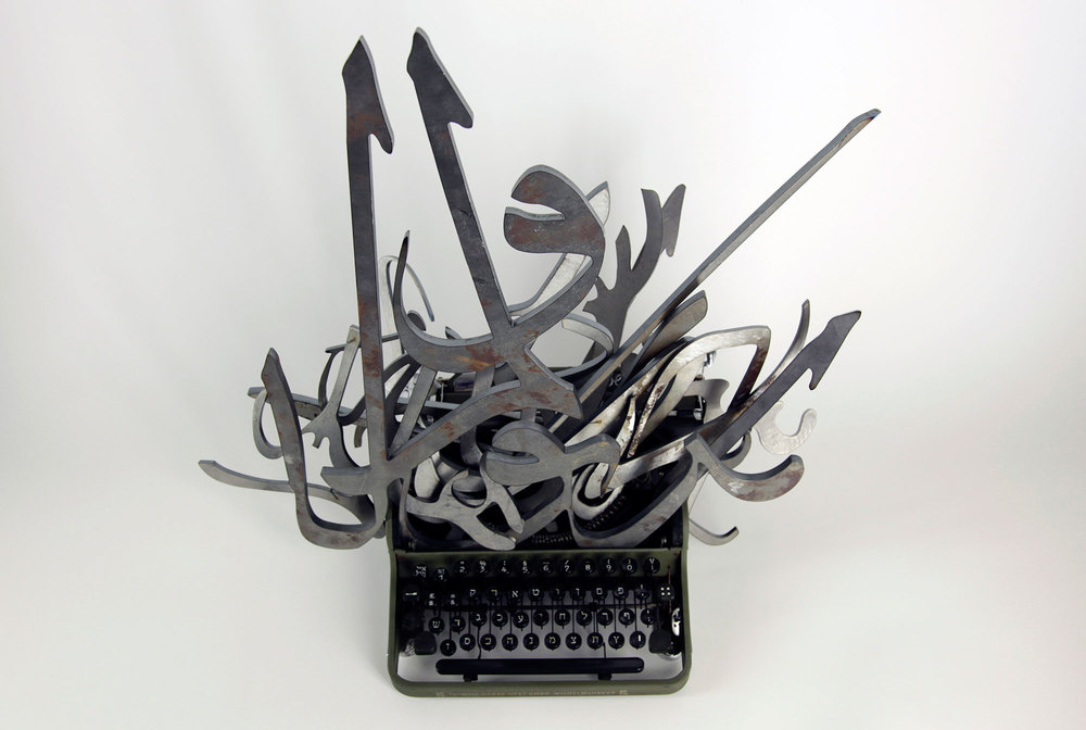 The Impossible Union, 2011, arabic calligraphies of steel, hebrew typewriter. Courtesy of the artist and Collection of the Kunstpalast Museum, Duesseldorf. Photo credit : Mounir Fatmi