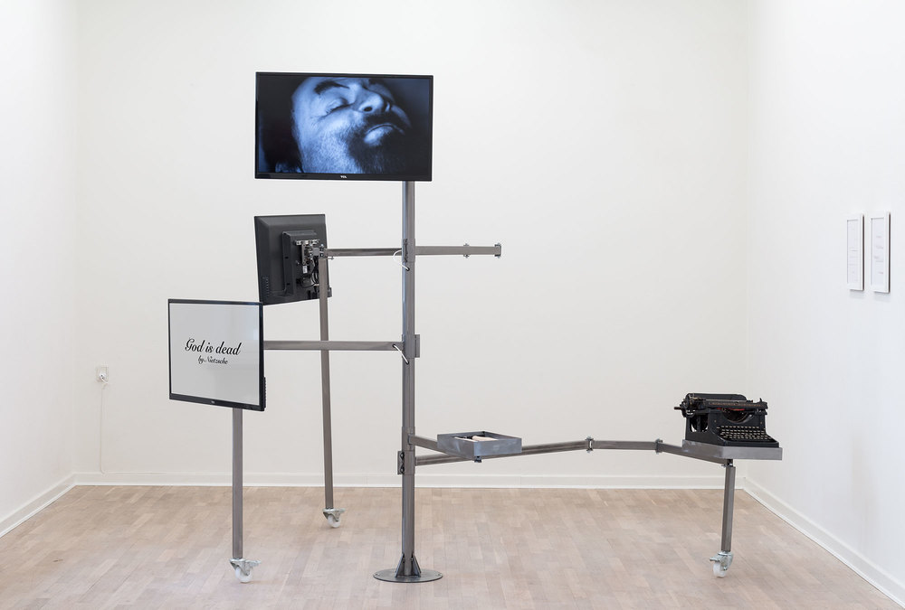 Deconstruction Structure N°1, 2013-2014, Typewriter, hammers, A4 paper on office desk, video on flatscreen, Bilboquet game, typed sheets. Courtesy of the artist and Goodman Gallery, Johannesburg-Cape Town. Exhibition view from Merchant of Dreams. Photo credit : Viborg Kunsthal
