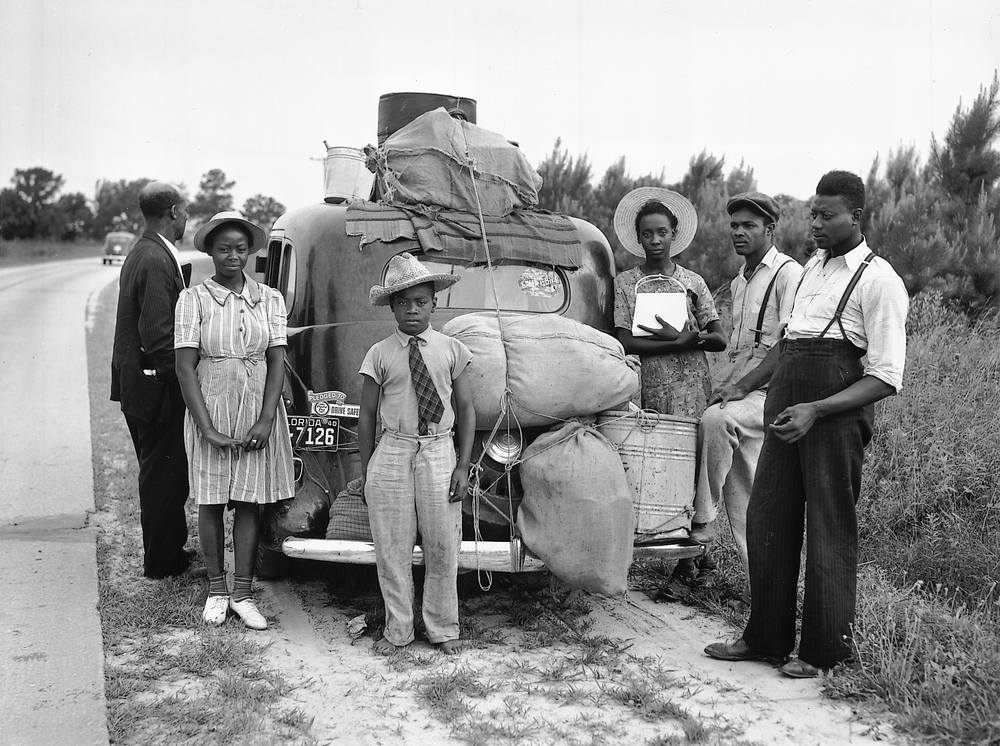 A group of Florida migrants on their way home to Cranberry. New Jersey, July 1940. Photography by Jack Delano.