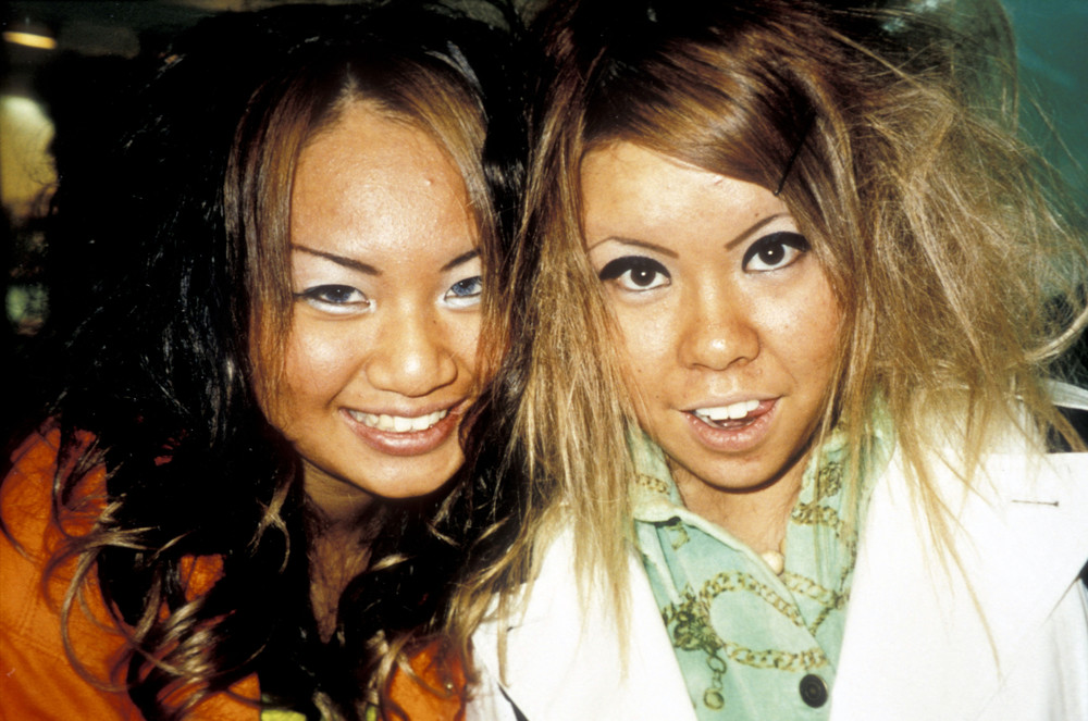 Two ganguro girls with heavy eye Make-up, Japan, 2000's by Ted Polhemus