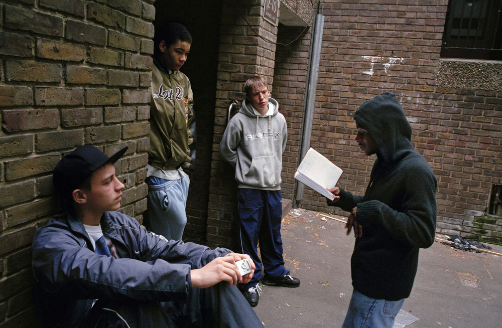 A young grime emcee recites his rhymes on a housing estate in Bow, East London. 2006 by Simon Wheatley