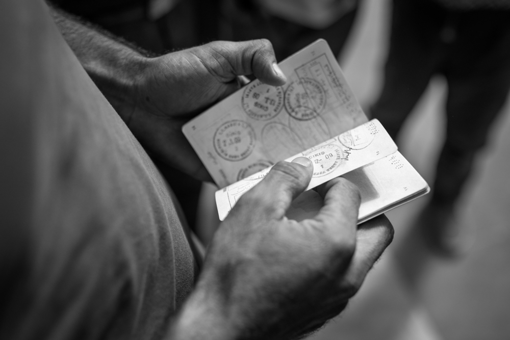 A Syrian refugee shows multiple Turkish entry stamps in his passport. Istanbul, Turkey. September 16, 2015. Photo by Miguel Winograd.