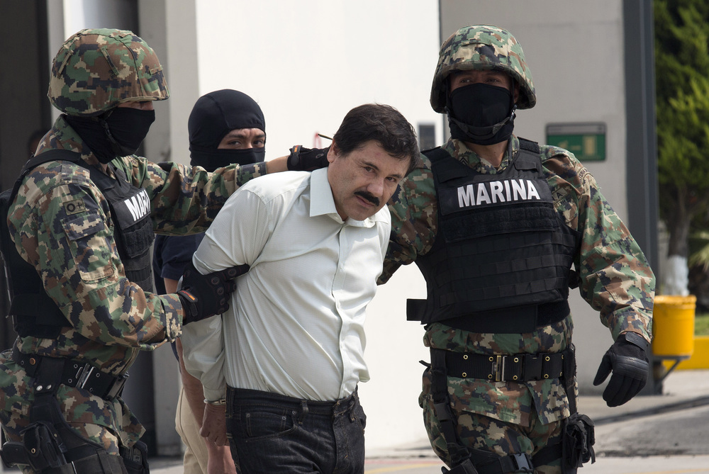 El Chapo handcuffed by navy marines in Mexico City, AP 2015