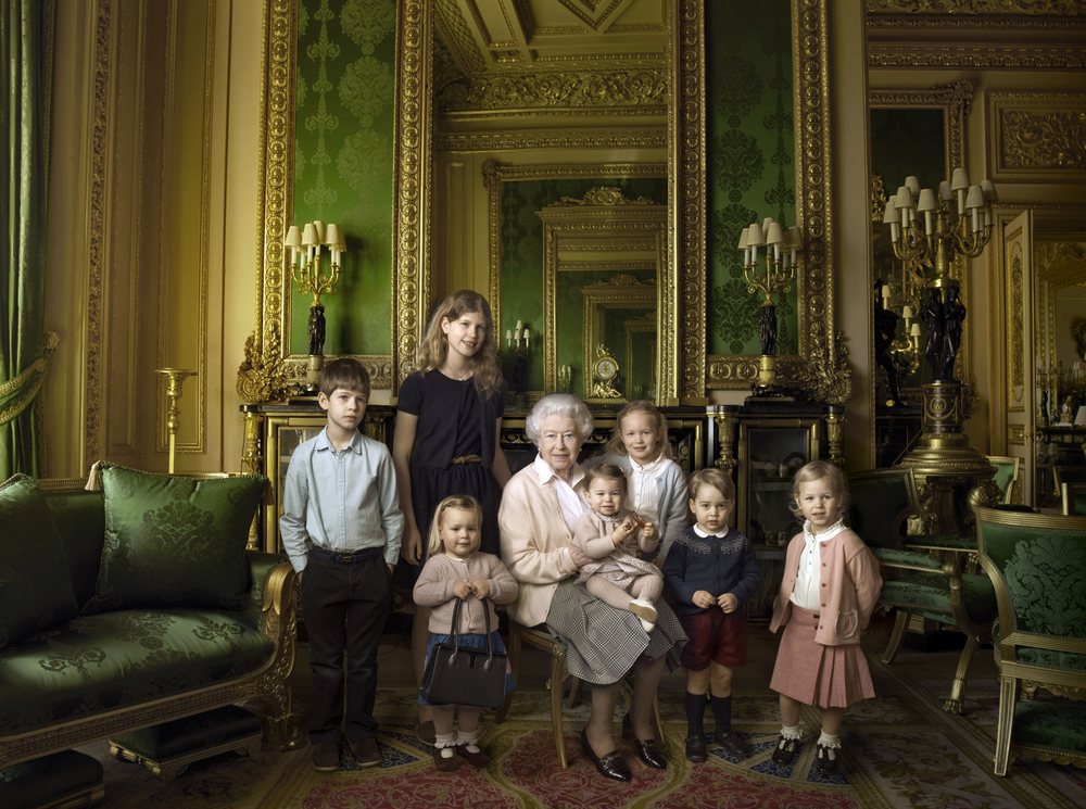 Queen Elizabeth II surrounded by her five great-grandchildren and her two youngest grandchildren. Photo by Annie Leibovitz/PA Wire, 2016.