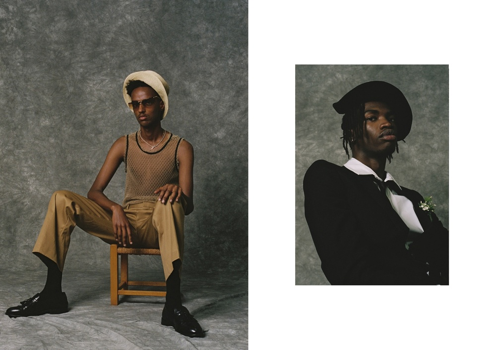 Left: Guled wears Trousers by Acne, Vest by Todd Lynn, Shoes from Rokit Vintage, Hat, Sunglasses and gold Necklace stylist's own and rope Necklace model's own. Right: Lance wears Trousers and Tie by Hedi Slimane for Saint Laurent, Shirt by Acne and Hat stylist's own.