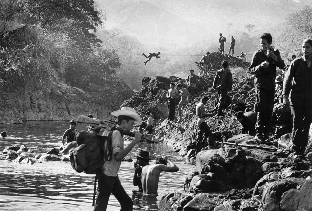Salvadoran troops cross the river Torola into guerrilla-held territory in Morazan province in the north east of the country. The river marked the dividing line between areas controlled by government and territory under the command of guerrilla forces, February 1984.