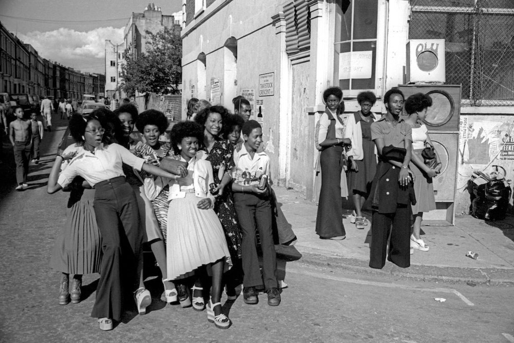 Group of girls standing on the corner of  Portobello Road  at Notting Hill Carnival, 1975. Photo source:  PYMCA  Archive.