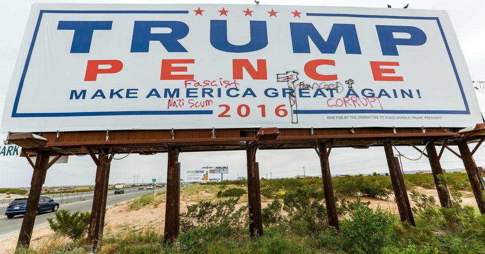 A Donald Trump billboard with graffiti, posted on the westbound side of US 70 between Mesa Grande Avenue and Sonoma Ranch Boulevard. Photo by Robin Zielinski.