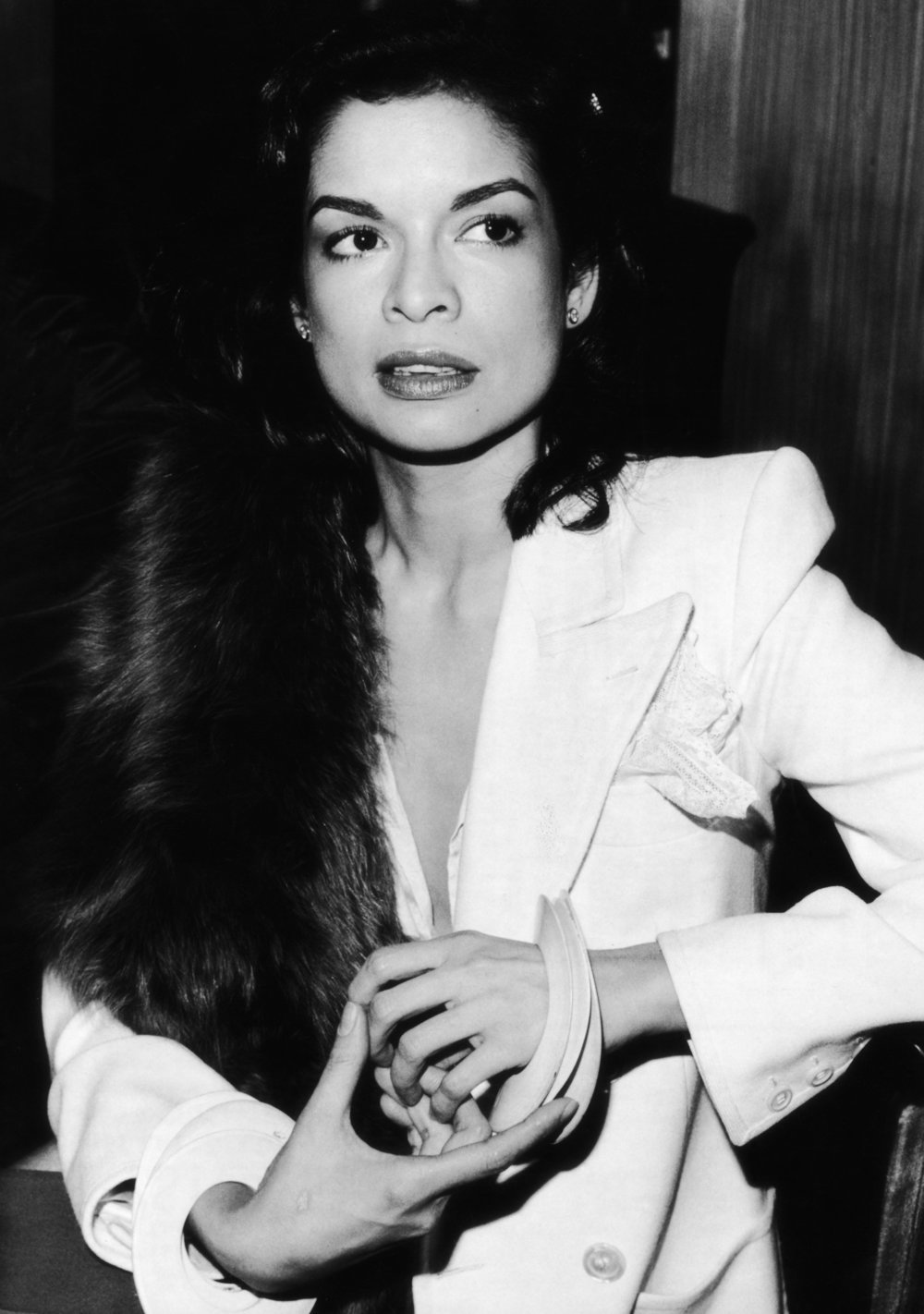 Bianca Jagger wearing Yves Saint Laurent 'Le Smoking' suit whilst attending a press conference in Munich for the film  The American Success Company , 1980. Photo source: The Red List.