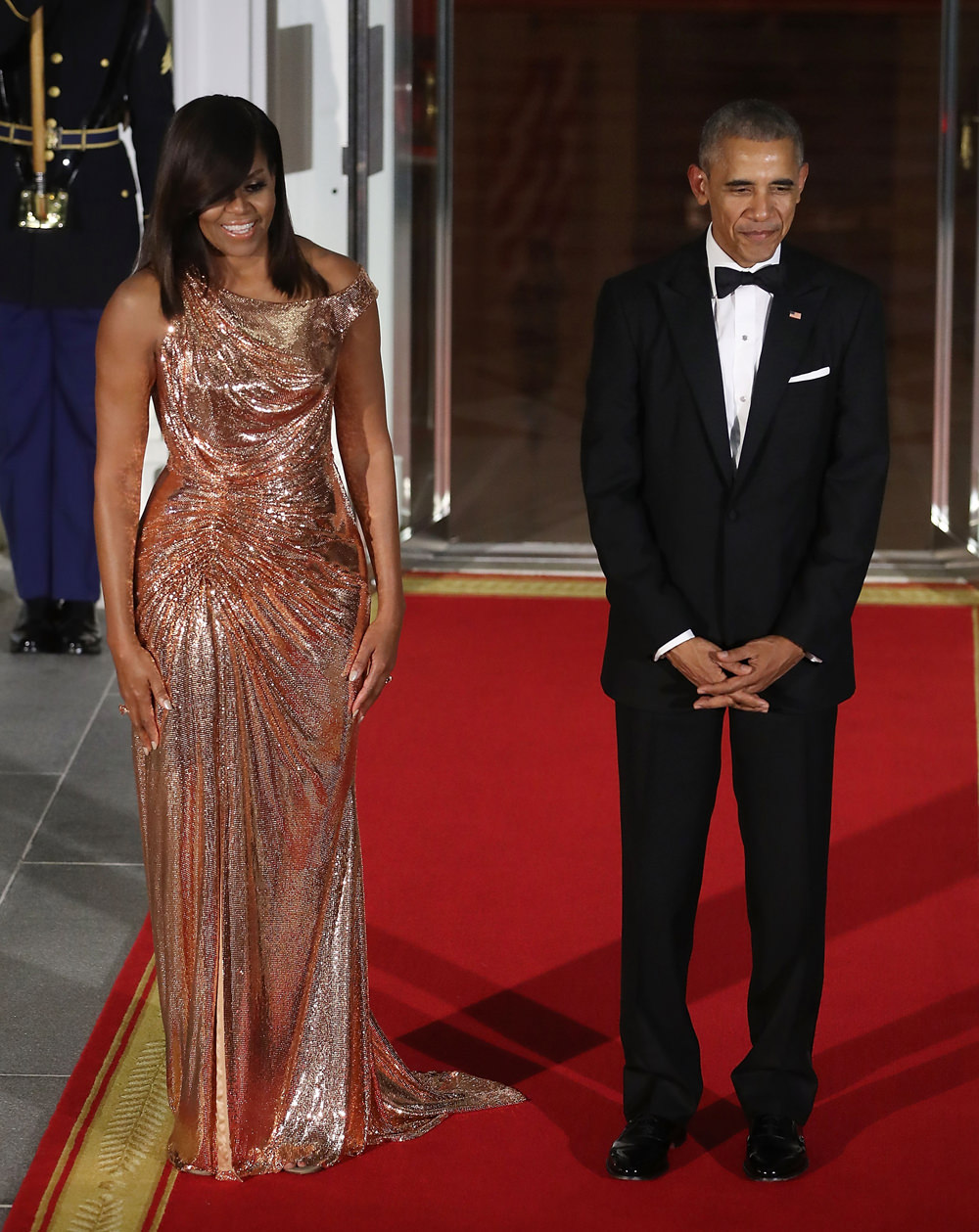 Michelle Obama and Barack Obama at the   White House state dinner, 2016. She wears a custom dress by Versace.   Photo source: Getty Images.