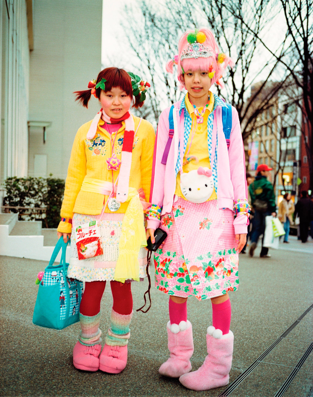 Two young girls dressed in Hello Kitty merchandise, Tokyo, Japan, 2000. Photo by Ben Knight.