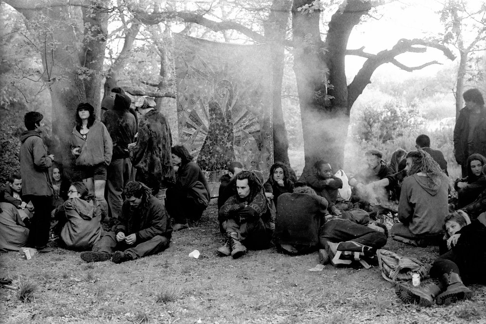 Group of travellers sitting around, Wanstead Common, UK, 1994. Photo by  Matthew Smith .