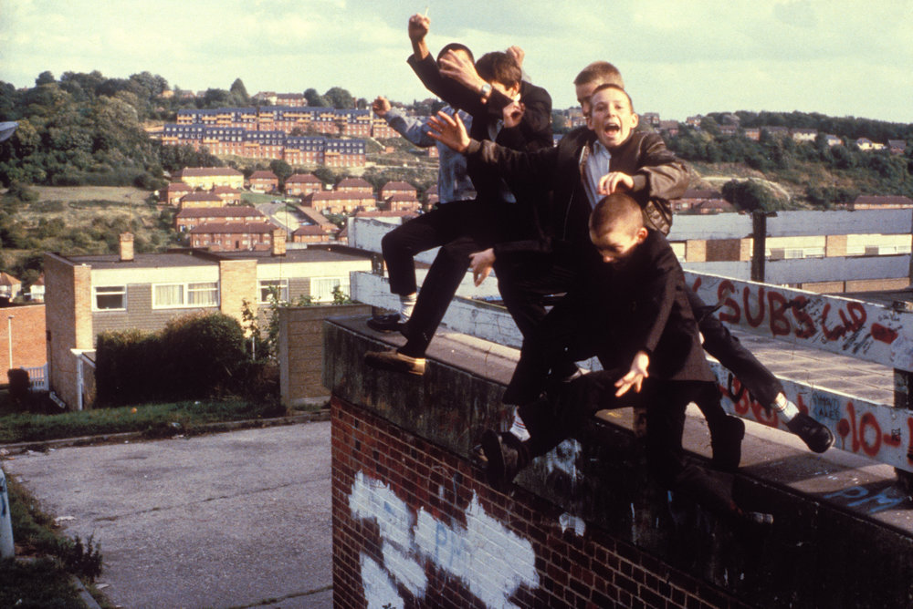 A group of Boys jumping off a roof, High Wycombe, UK 1980's.  Photo by  Gavin Watson.