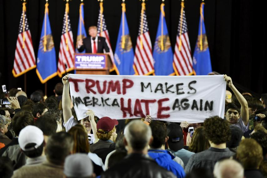 Protestors hold up a sign at a rally for Donald Trump at Oral Roberts University in Tulsa, Oklahoma, January 20, 2016. Photo by Nick Oxford/ Reuters.
