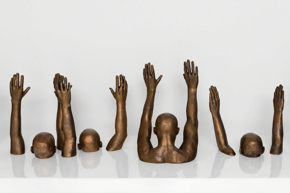 Raise Up , 2014 by Hank Willis Thomas.
