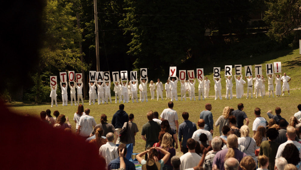 The Guilty Remnants holding up a message in a scene from The Leftovers. Photo source: HBO.
