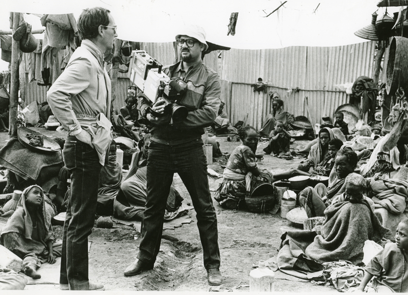 Michael Buerk and Mohamed Amin reporting the Ethiopian Famine, 1984. Photo source: Hurst Publisher.