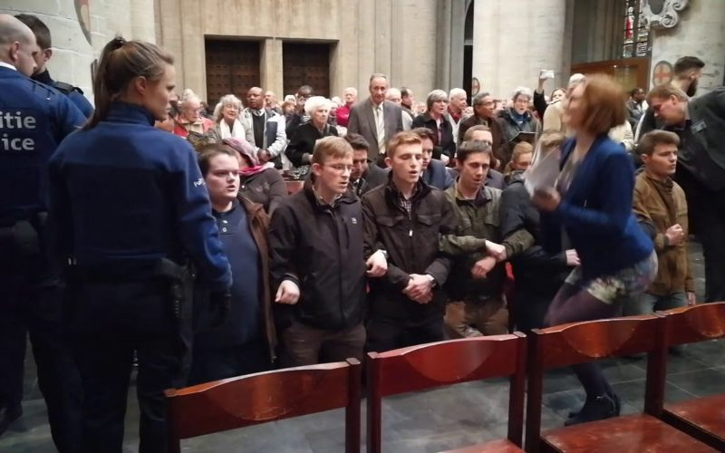 Police escort young Catholics praying the rosary out of an ecumenical service to mark the Reformation. Photo source: Youtube.com