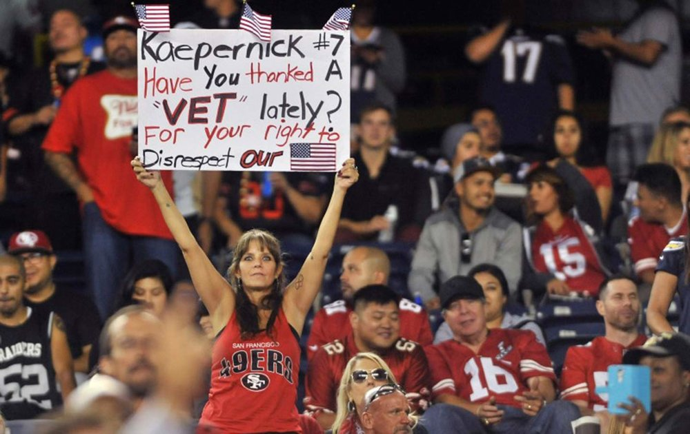 A San Francisco 49ers fan holds up a sign in reference to quarterback Colin Kaepernick during the second half of the game against the San Diego Chargers at Qualcomm Stadium. Photo Credit: Orlando Ramirez/USA Today Sports.