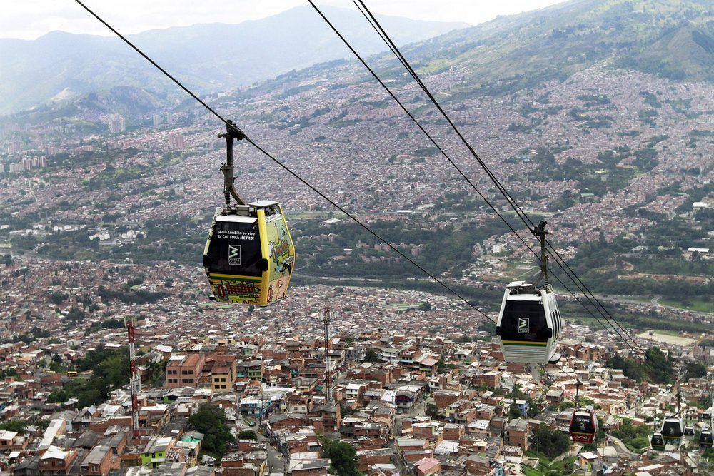 Cable cars pass above the town of Medellín, Colombia. Photo by Albeiro Lopera/Reuters.
