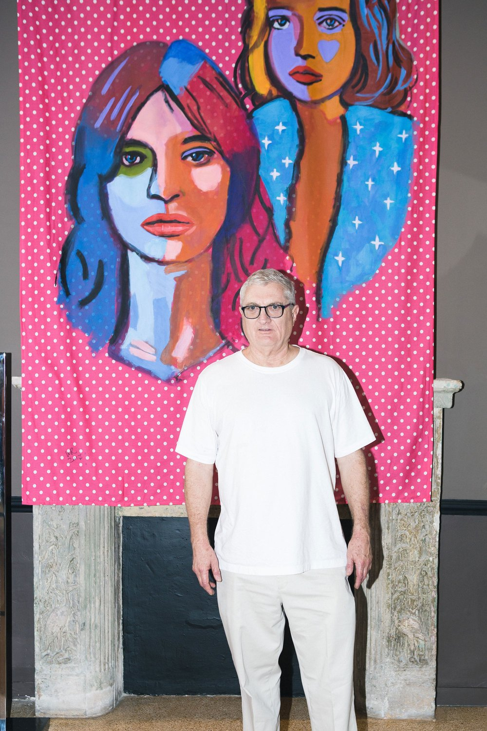 Walter Robinson next to his artwork as Sies Marjan, The Webster, and RxArt host an event for the launch of the illustration book: Between the Lines, 2017. Photo source: British Vogue.