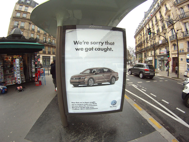 We're sorry that we got caught  - fake Volkswagen billboard in Paris.