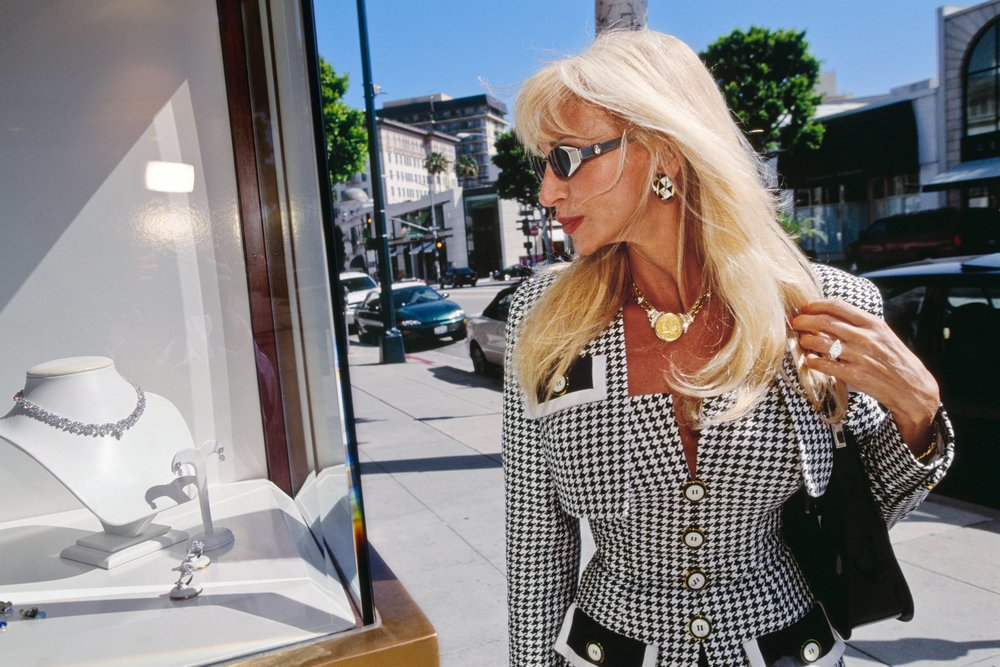 A woman browses on Rodeo Drive, Beverly Hills, 2000 by Lauren Greenfield.