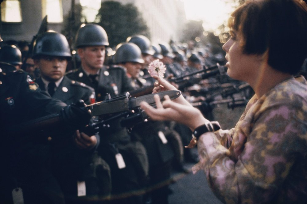 Jan Rose Kasmir confronts the American National Guard outside the Pentagon in Washington during the 1967 anti-Vietnam march. Photo by Marc Riboud.