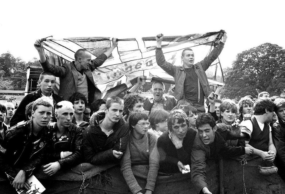 Skinheads with flag at Loch Lomond Festival , 1980 by Janette Beckman.
