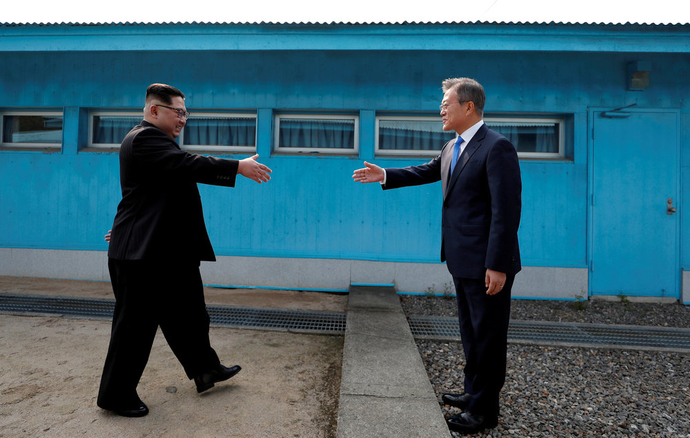 North Korean Leader Kim Jong Un and South Korean President Moon Jae-in at the Demilitarized Zone that separates the two countries. Photo source: Getty Image.